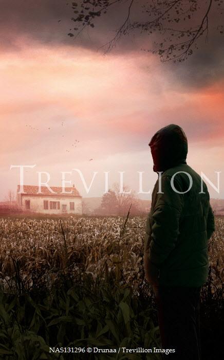 Drunaa Hooded man in corn field looking at house