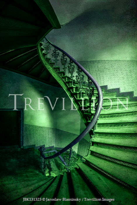 Jaroslaw Blaminsky GREEN SPIRAL STAIRCASE IN OLD BUILDING Stairs/Steps