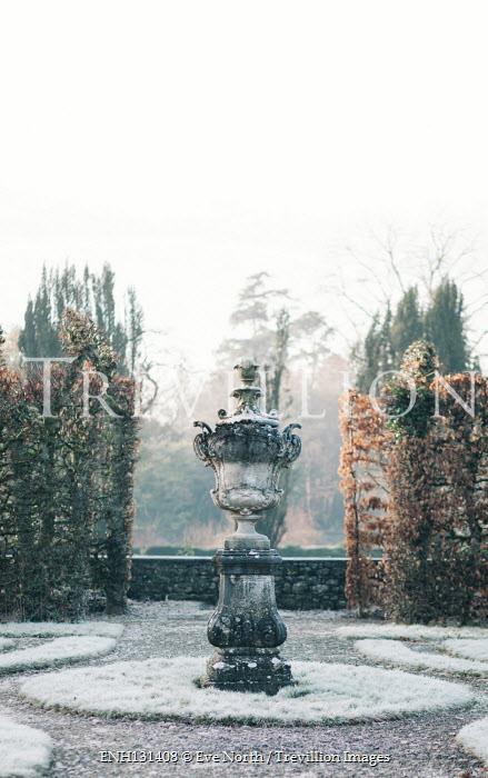 Eve North Stone statue in garden during winter