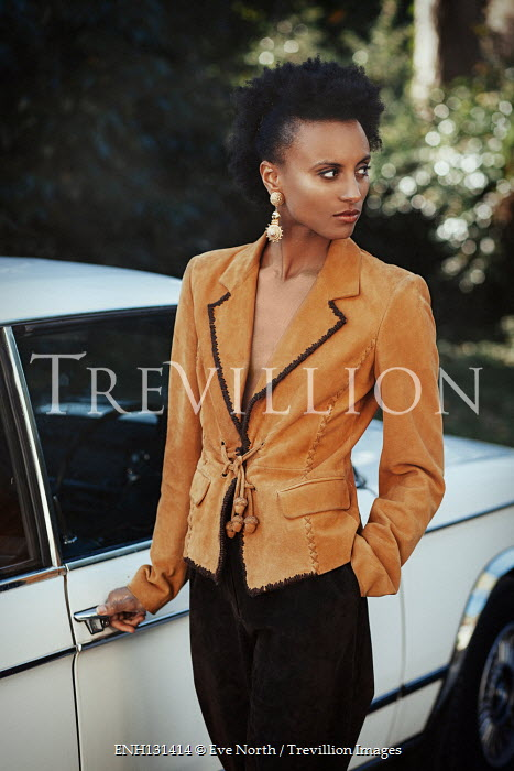 Eve North Young woman in blazer by car