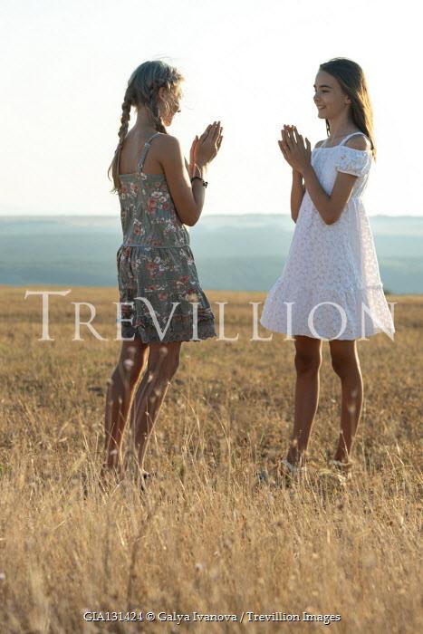 Galya Ivanova Smiling teenage girls in field
