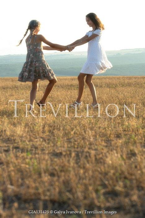 Galya Ivanova Teenage girls dancing in field