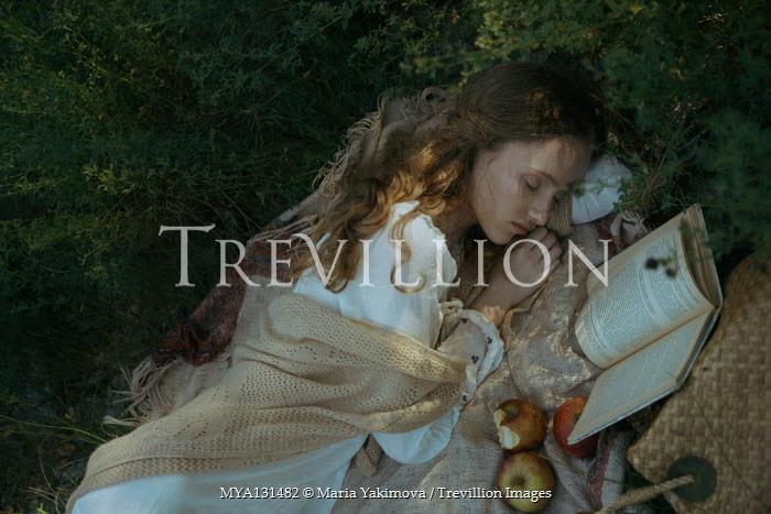 Maria Yakimova Young woman sleeping on picnic blanket