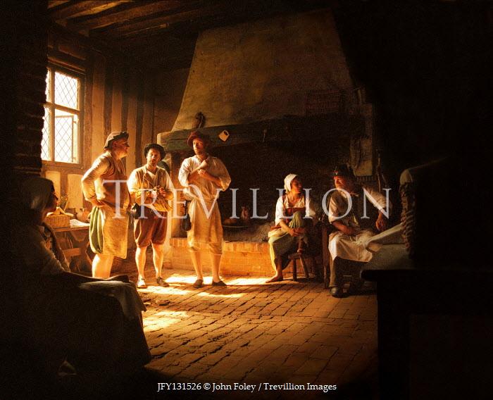 John Foley Men and women in historic inn
