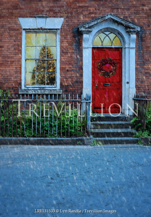 Lyn Randle Red door to house with Christmas wreath and Christmas tree in window