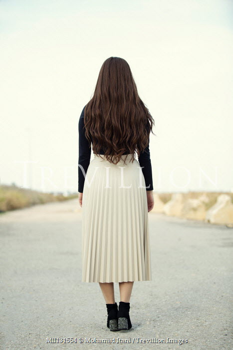 Mohamad Itani Young woman standing on road