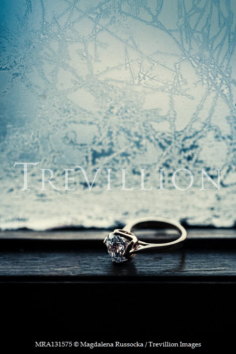 Magdalena Russocka engagement ring with diamomd on window sill