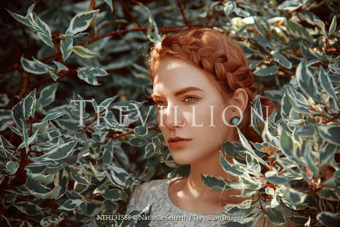Nathalie Seiferth Young woman among branches of tree