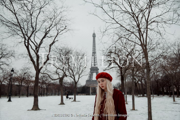 Nathalie Seiferth Young woman in winter park by the Eiffel Tower in Paris, France