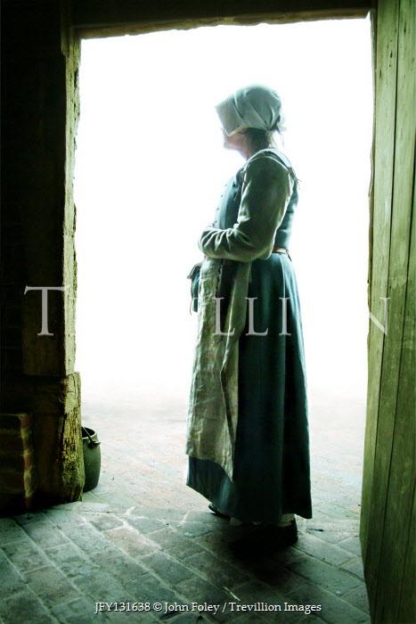 John Foley Maid standing in doorway