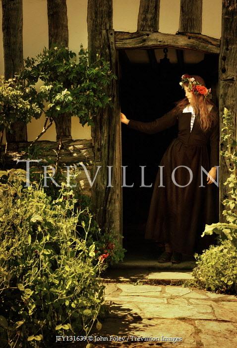John Foley Historic woman standing in doorway