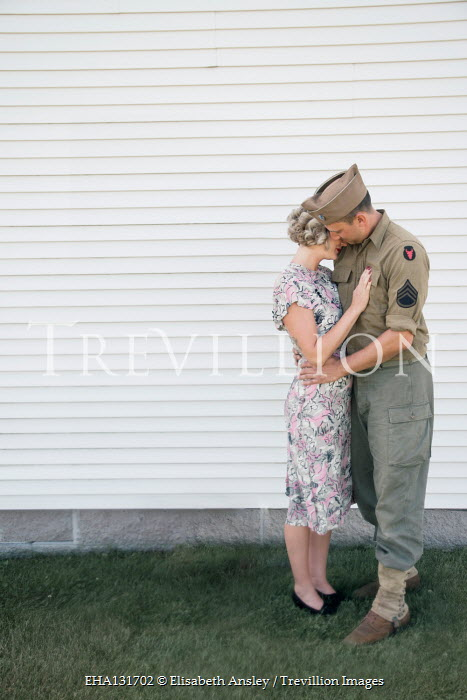 Elisabeth Ansley WARTIME COUPLE EMBRACING OUTDOORS BY BUILDING Couples