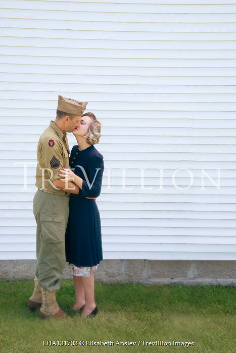 Elisabeth Ansley WARTIME COUPLE KISSING OUTDOORS BY BUILDING Couples