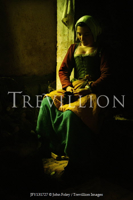 John Foley MEDIEVAL WOMAN SITTING BY HEARTH IN SHADOW Women