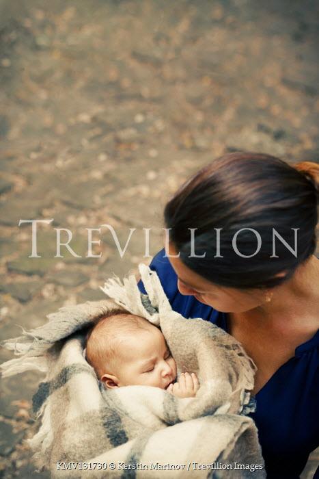 Kerstin Marinov WOMAN HOLDING BABY IN BLANKET OUTDOORS Children