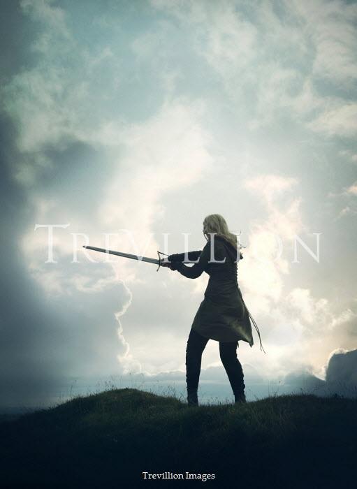Mark Owen BLONDE WOMAN WITH SWORD IN COUNTRYSIDE Women
