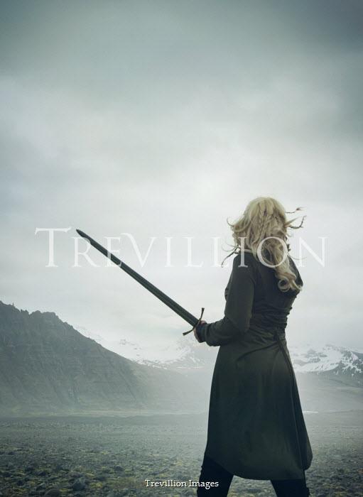 Mark Owen WOMAN WITH SWORD WATCHING SNOWY MOUNTAINS Women