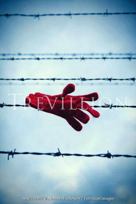 Natasza Fiedotjew Red woolen glove hanging on barbed wire
