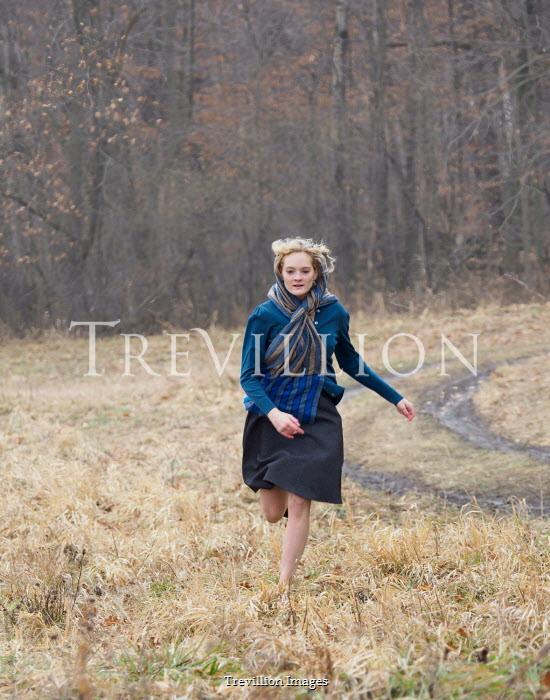 Elisabeth Ansley BLONDE GIRL RUNNING IN COUNTRYSIDE Women