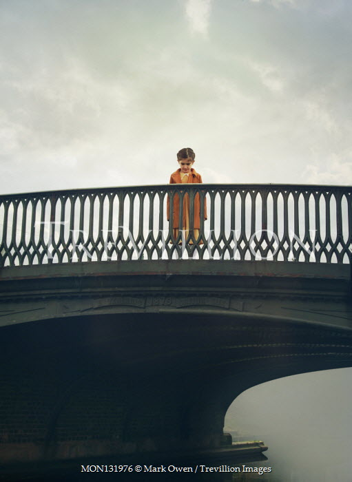 Mark Owen LITTLE GIRL STANDING ON BRIDGE OVER RIVER Children
