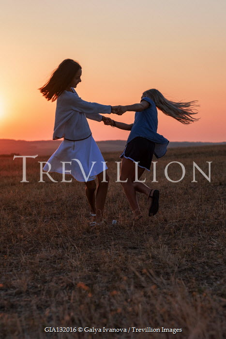 Galya Ivanova TWO YOUNG GIRLS PLAYING IN FIELD AT SUNSET Couples