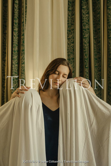 Irene Gittarelli DREAMY WOMAN TOUCHING PEOPLE COVERED WITH SHEETS Groups/Crowds