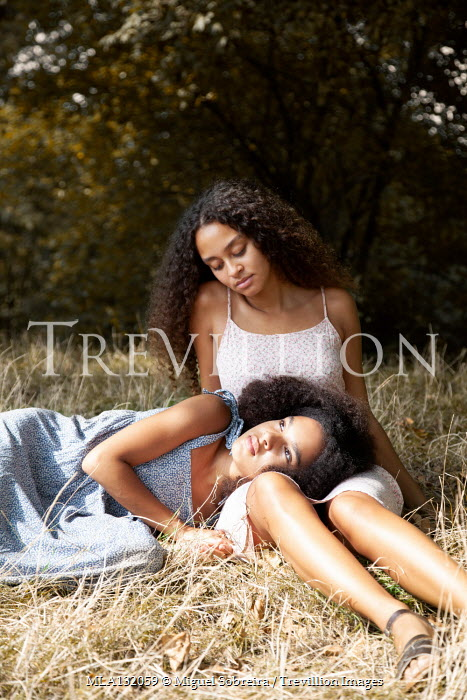 Miguel Sobreira MOTHER AND DAUGHTER RELAXING IN SUMMERY COUNTRYSIDE Women