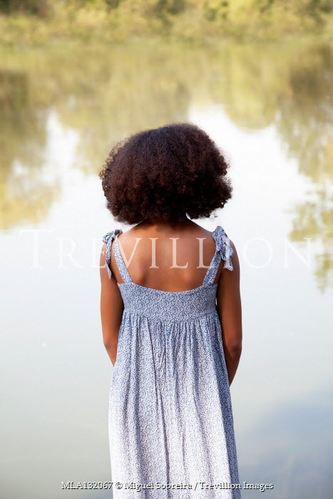 Miguel Sobreira YOUNG GIRL IN SUMMER DRESS WATCHING LAKE Children