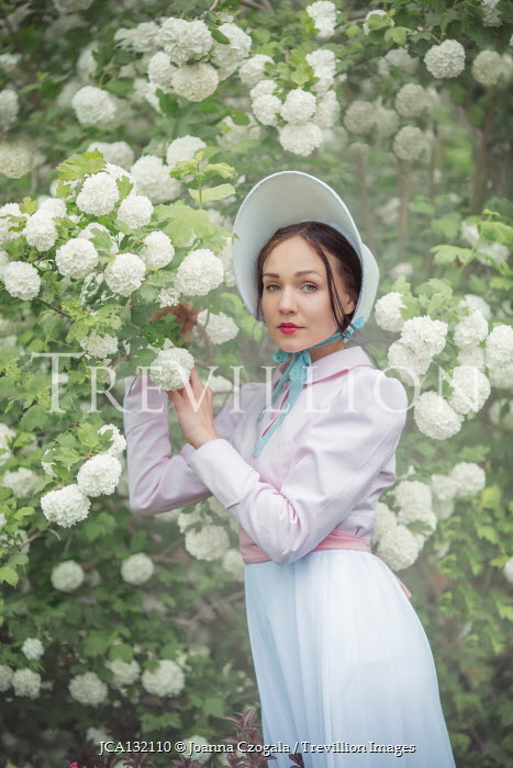 Joanna Czogala WOMAN WITH BONNET BY BUSH WITH WHITE FLOWERS Women