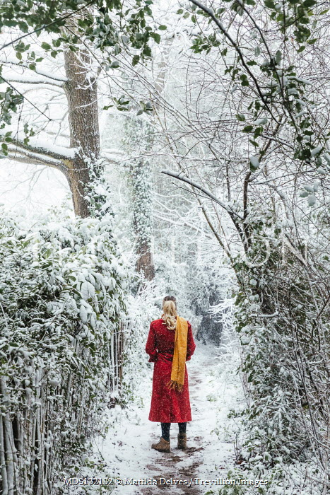 Matilda Delves BLONDE WOMAN IN RED COAT ON SNOWY PATH Women