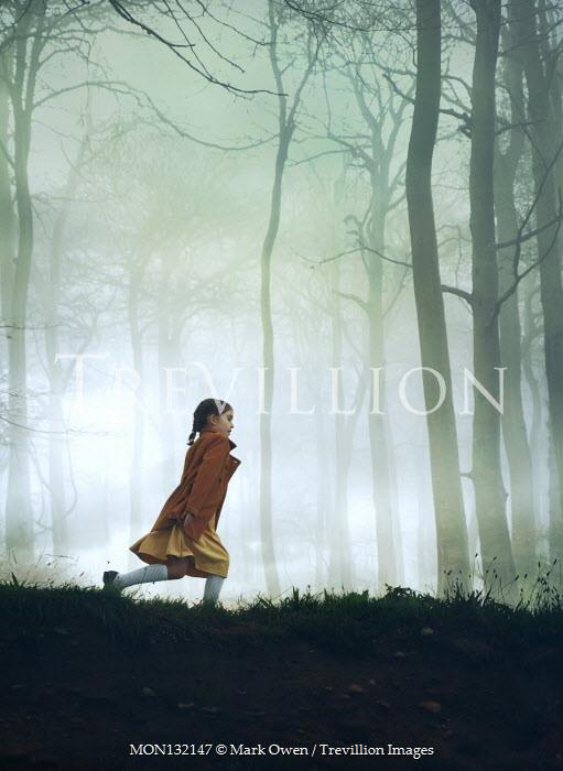 Mark Owen LITTLE GIRL WITH COAT RUNNING IN FOGGY FOREST Children