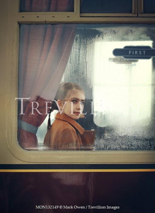 Mark Owen LITTLE GIRL SITTING IN RETRO TRAIN Children