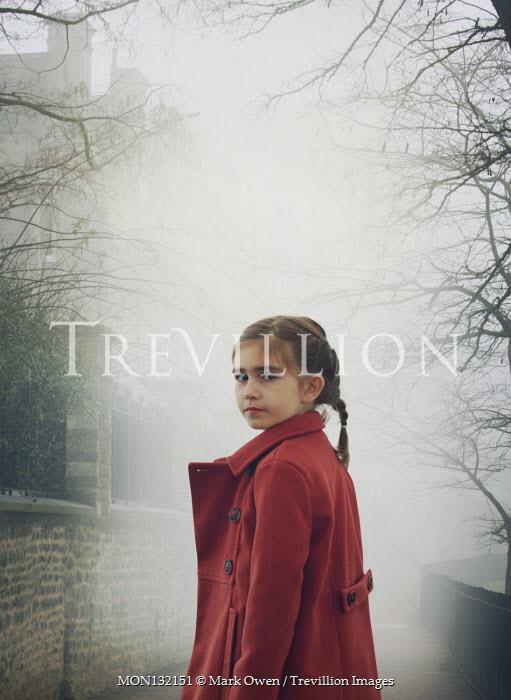 Mark Owen LITTLE GIRL WITH COAT IN FOGGY PATHWAY Children