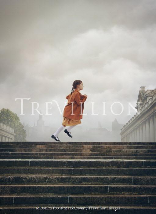 Mark Owen LITTLE GIRL RUNNING BY GRAND BUILDINGS IN CITY Children