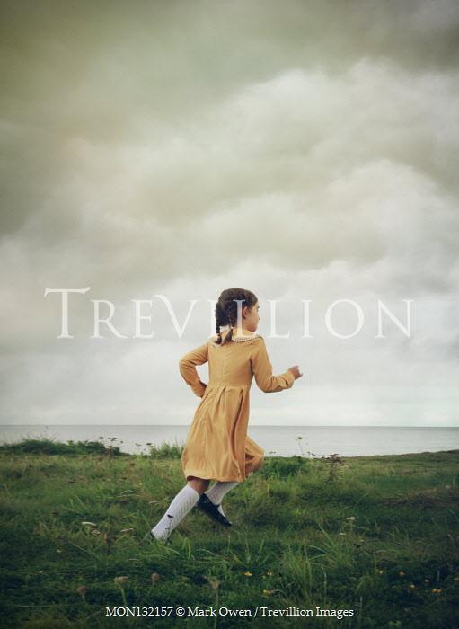 Mark Owen LITTLE GIRL IN DRESS RUNNING BY SEA Children