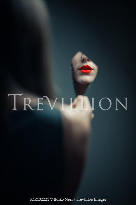 Ildiko Neer Woman's red lips reflecting in broken mirror