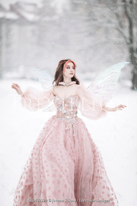 Jovana Rikalo WOMAN WITH WINGS AND PINK GOWN IN SNOW Women
