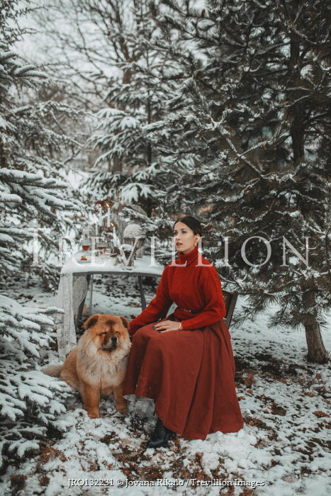 Jovana Rikalo WOMAN WITH DOG SITTING AT TABLE IN SNOW Women