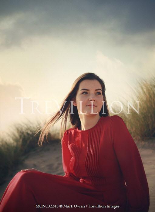 Mark Owen WOMAN SITTING ON BEACH WITH SAND DUNES Women