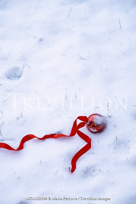 Maria Petkova RED BAUBLE AND RIBBON LYING IN SNOW Miscellaneous Objects