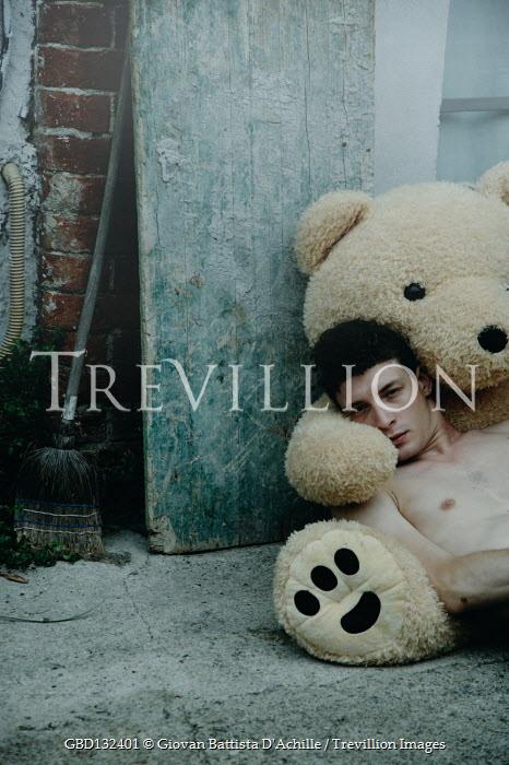 Giovan Battista D'Achille BARE CHESTED MAN LYING ON LARGE TEDDY OUTDOORS Men