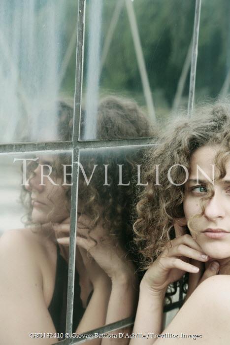 Giovan Battista D'Achille SERIOUS WOMAN REFLECTED MIRRORED BUILDING Women