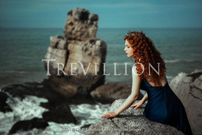 Katerina Klio WOMAN WITH CROWN SITTING ON ROCK BY SEA Women