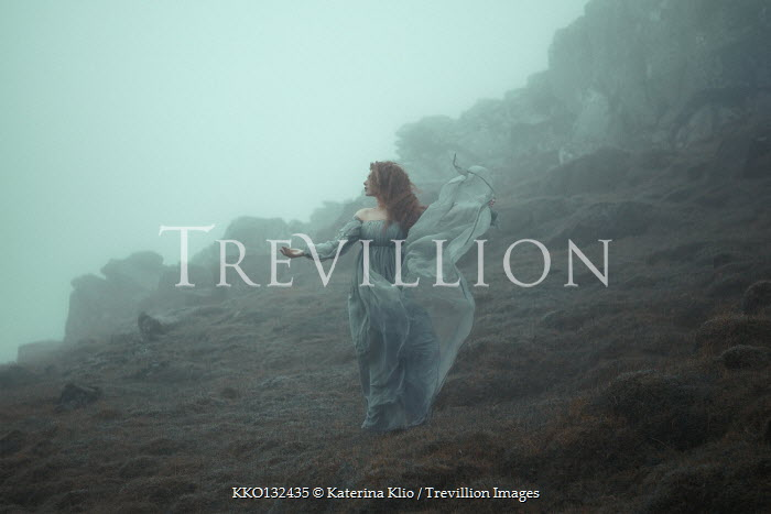 Katerina Klio WOMAN WITH FLOWING GOWN ON MISTY MOUNTAIN Women