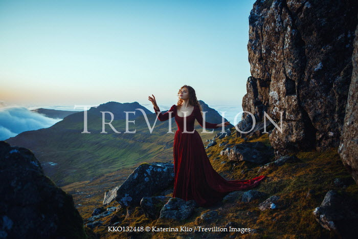 Katerina Klio WOMAN IN RED DRESS STANDING ON MOUNTAIN Women