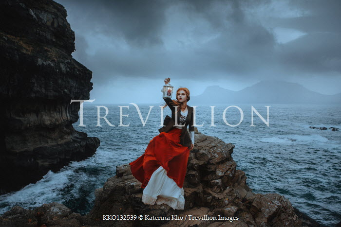 Katerina Klio WOMAN WITH LANTERN BY SEA AT DUSK Women