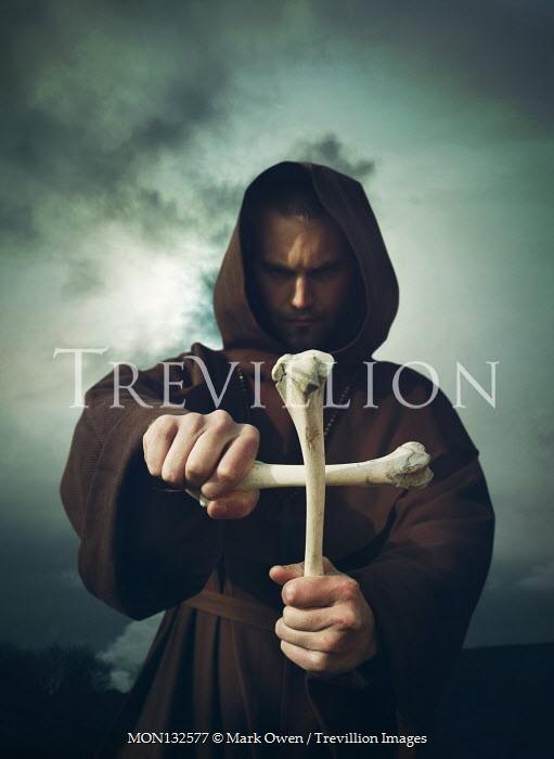 Mark Owen PRIEST MAKING CRUCIFIX OF BONES OUTDOORS Men