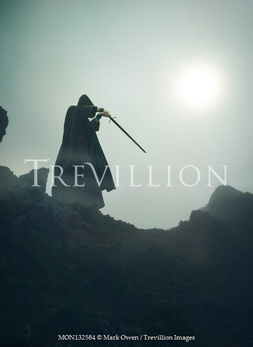 Mark Owen MAN WITH CAPE AND SWORD ON CLIFF Men
