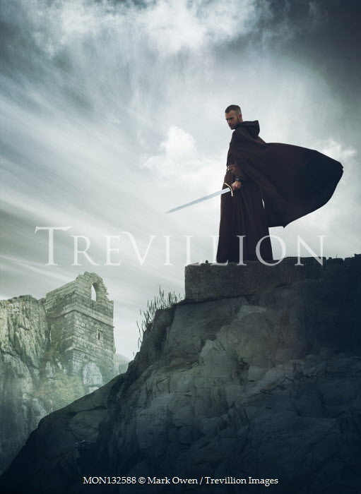 Mark Owen MAN WITH CAPE AND SWORD BY BUILDING ON CLIFF Men