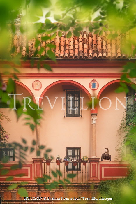 Evelina Kremsdorf WOMAN STANDING ON BALCONY OF SPANISH HOUSE Women